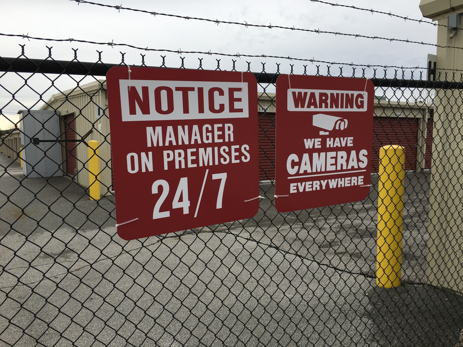 Manager on Property and Notice of Cameras signs
